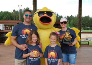 family at duck race